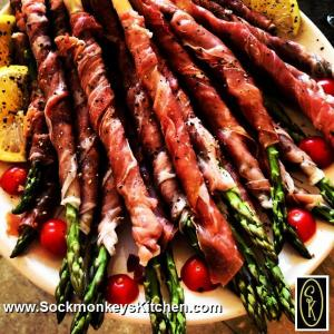 Here's an appetizer Tracie and I made for one of her parties: Wrap the proscuitto down the asparagus spear, drizzle with a good quality olive oil, and add cracked pepper and pink salt. Cut in thirds to serve.