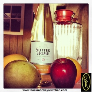 Any white wine will do. I use Sutter Home Moscatto, because it's a sweet wine, and even the tangiest grapefruit will stay sweet in it.