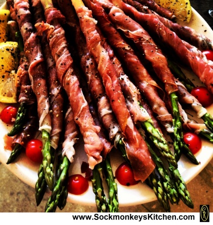 Steam asparagus, spiral-wrap in prosciutto, sprinkle with cracked black pepper & lightly grill for 1-2 minutes in the broiler.