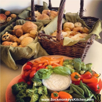 An assortment of muffins, croissants and rolls from the bakery look pretty when presented in baskets with cloth napkins.   When arranging vegetables on a platter, make sure to place different colors together. It's nice to finish off your dip with a fresh stalk of basil or other fresh herb.