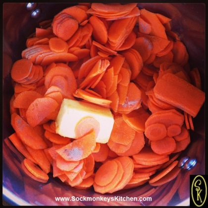 Put carrots, water, butter, salt and white pepper in large pot.