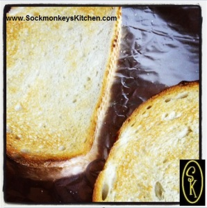 Toast the sourdough slices in the broiler: 1-2 minutes on each side till golden.