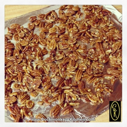 Lay out honeyed pecans on a foil-lined baking sheet and bake for 10 minutes