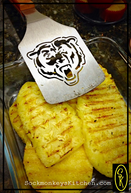 Cutting large slices of pineapple makes it easy to turn them on the grill.